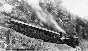 Early photo of the Cog Train at Son-of-a-Gun hill. Photo by J.G. Heistand, courtesy of the Special Collection Department at Pikes Peak Library.