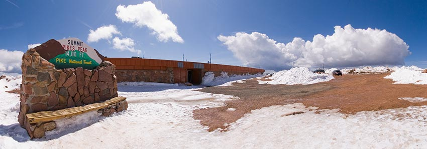The west side of the Pikes Peak Summit House after late snow in May.